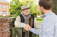 locksmith brighton neighbours shaking hands over fence